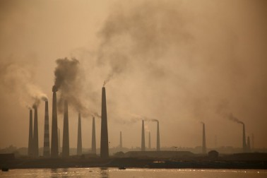 The cluster of 500 kilns north of Dhaka is responsible for 40 percent of the city's particulate air pollution. (Zaki Ameen/ Demotix)