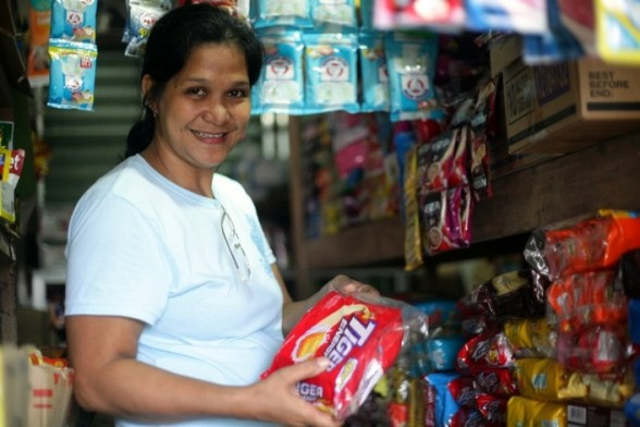 LeiLani Rebong started out selling diapers ten years ago. She now owns a full sari-sari store and pioneered mobile money transfers as a growth business. (Anna Valmero)