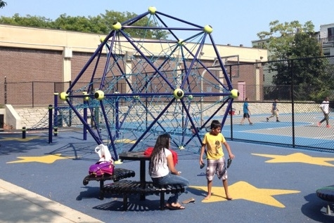 Renovations of the Paris Street Park include new playground equipment and two things teenagers asked for: fountains to refill water bottles and cell phone chargers. (Neal Peirce)