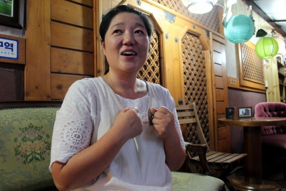 Cho Ehwa says her restaurant has attracted more customers since sidewalks were widened and traffic was calmed outside. (Anna Valmero)