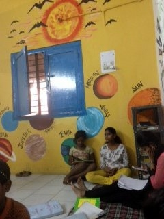 The library at Khushi Rainbow Home is more popular since the residents painted it. (Patralekha Chatterjee)