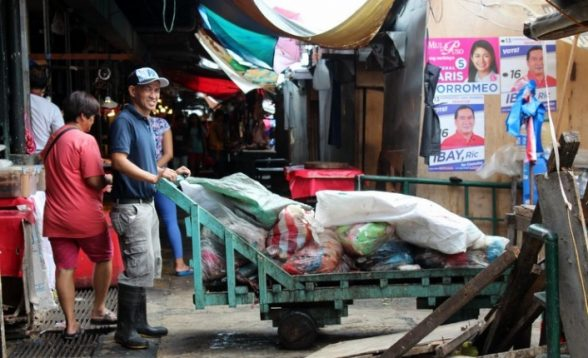 Trash collection has been implemented in a market that used to dump garbage in the creek. (Anna Valmero)