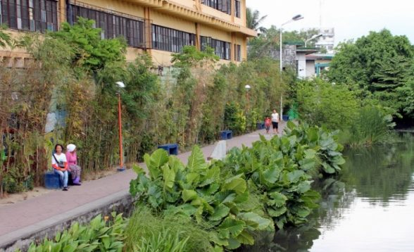 A new riverbank pathway provides open space prevents flooding. (Anna Valmero)
